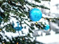 blue bauble on green christmas tree