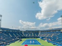 people standing on blue and green tennis court
