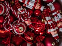 red christmas toys in plastic container