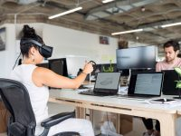 women using computer with vr headset